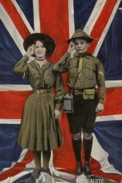 Girl Guide and Boy Scout Saluting in Front of the Union Flag