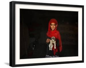 Girl Holds a Puppy as the Sun Sets over Kabul's Impoverished Teppe Maranjan Neighborhood