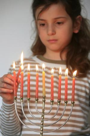 https://imgc.allpostersimages.com/img/posters/girl-lighting-hannuka-candles-montrouge-france_u-L-Q1GYHL20.jpg?artPerspective=n