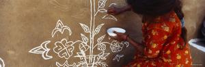 Girl Painting on a Wall, Thar Desert, Jaisalmer, Rajasthan, India