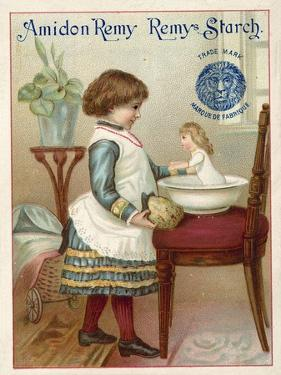Girl Washing a Doll
