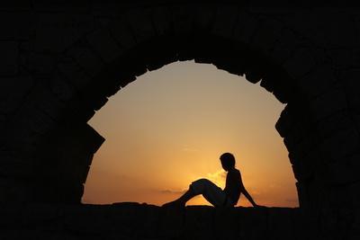 https://imgc.allpostersimages.com/img/posters/girl-watching-sunset-in-cesarea_u-L-Q1GYLME0.jpg?artPerspective=n