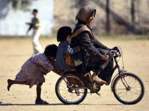 Girls Play on a Bike in Jammu, India