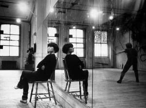 Choreographer Twyla Tharp Observing a Dancer Rehearse. Both Reflected in Mirror by Gjon Mili
