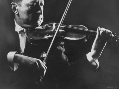 Close Up of Violinist Jascha Heifetz Playing in Mili's Darkened Studio