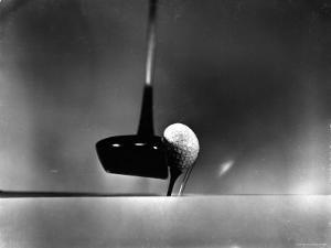 Close Up Shot of Driver Club Head Impacting Ball on Tee by Gjon Mili