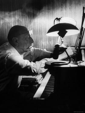 Composer Igor Stravinsky Working at a Piano in an Empty Dance Hall in Venice by Gjon Mili