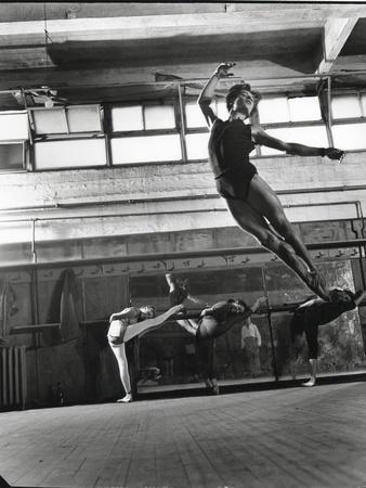 Jean Babilee, Star of Ballets Des Champs Elysees, Leaping During Practice as Other Dancers Watch