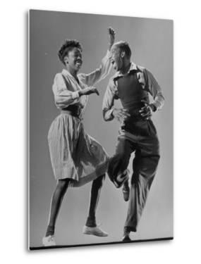 Leon James and Willa Mae Ricker Demonstrating a Step of the Lindy Hop by Gjon Mili