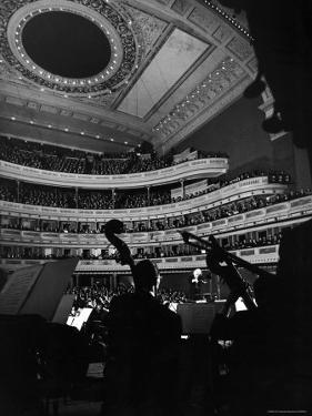 Leopold Stokowski Conducting the New York Philharmonic Orchestra in Performance at Carnegie Hall by Gjon Mili