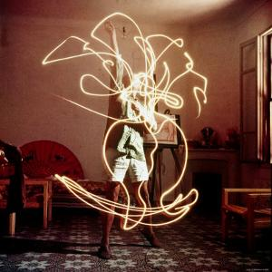 Pablo Picasso Creating Light Drawing of Vase of Flowers, Alone by Gjon Mili