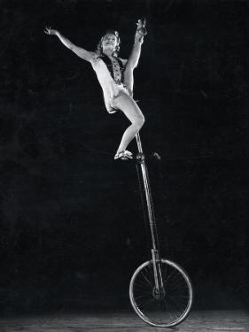 Performer Hanny Shyretto on a Unicycle by Gjon Mili