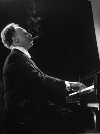 Pianist Arthur Rubenstein at the Piano, Smoking Cigar