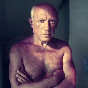 Portrait of Artist Pablo Picasso, Arms Folded Across Bare Chest, at His Home, Alone by Gjon Mili