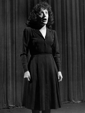 Singer Edith Piaf Singing on Stage by Gjon Mili