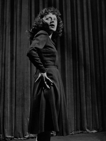 Singer Edith Piaf with Hands on Hips, Standing on Stage by Gjon Mili