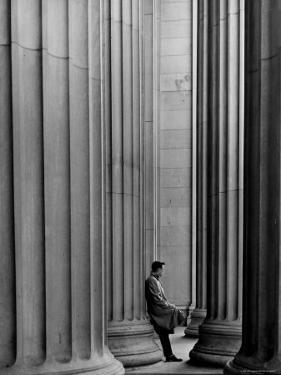 Student Leaning Against Ionic Columns at Entrance of Main Building at MIT by Gjon Mili