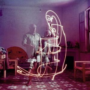 Triple Exposure of Artist Pablo Picasso Drawing with Light at His Home in Vallauris by Gjon Mili