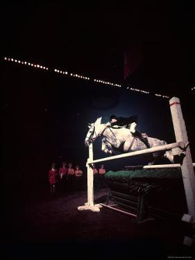 Woman Rider Taking Horse over Jump during National Horse Show by Gjon Mili