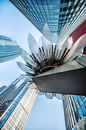 https://imgc.allpostersimages.com/img/posters/glass-and-metal-lotus-installation-in-front-of-hsbc-bank-with-surrounding-new-skyscrapers_u-L-PWFF170.jpg?p=0