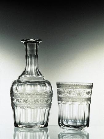 https://imgc.allpostersimages.com/img/posters/glass-bottle-and-glass-drinking-glass_u-L-POP60F0.jpg?p=0