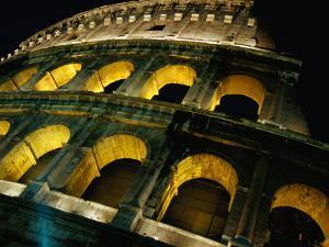 Colosseum Illuminated at Night Rome, Italy by Glenn Beanland