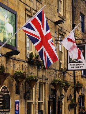 Flags Hanging Outside a Pub, Stow-On-The-Wold, Gloucestershire, England by Glenn Beanland