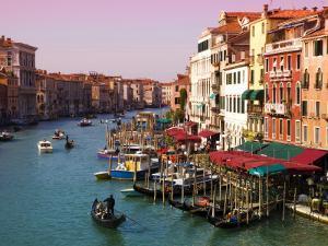 Gondolas on the The Grand Canal by Glenn Beanland