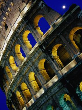 The Colosseum Lit Up at Night, Rome, Lazio, Italy by Glenn Beanland