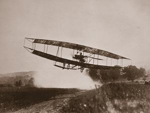 Glenn Curtiss Making the First Heavier-Than-Air Flight in the June Bug