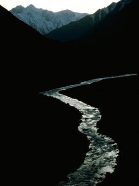 Glistening in the Light, the Obhingo River Flows Down Through the Mountain Vall Eys of Tajikistan