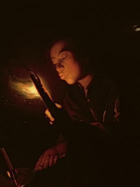Boy Blowing on a Firebrand to Light a Candle, C.1692-98 by Godfried Schalcken