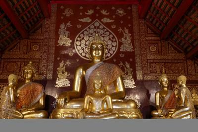 Buddha and disciple statues in Wat Pan Ping, Chiang Mai, Thailand, Southeast Asia, Asia by Godong