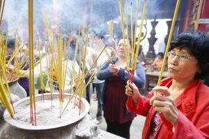 Burning incense during Tet, the Vietnamese lunar New Year celebration, Thien Hau Temple by Godong