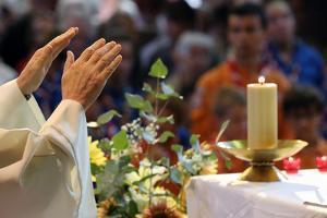 Catholic Mass, Eucharist celebration, France by Godong