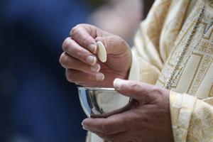 Holy Communion, Catholic Mass, France by Godong
