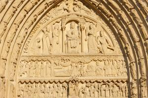St. Anne's gate tympanum, west front, Notre Dame Cathedral, France by Godong