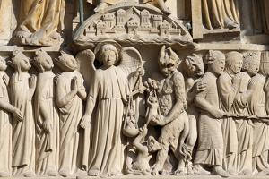 St. Michael weighing the souls, Portal of the Last Judgement, Notre Dame de Paris Cathedral by Godong