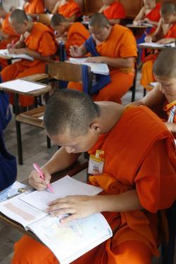 Students taking an exam, Mahachulalongkornrajavidalaya University, Chiang Mai campus, Thailand by Godong