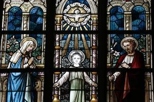 The Holy Family Depicted in a Stained Glass Window by Godong