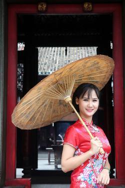 Woman wearing Vietnamese tradition dress called Ao Dai, Taoist temple, Phuoc An Hoi Quan Pagoda by Godong