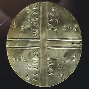 Gold Embossed Disk Showing Geometric Motifs and a Pair of Stylized Birds