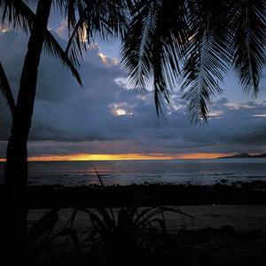 Golden Tropical Sunset Over Dark Ocean