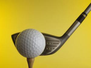 Golf Ball on Tee with Club