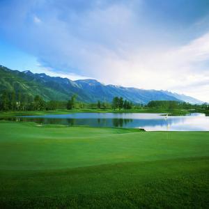 Golf Course with Mountain Range in the Background, Teton Pines Golf Course, Jackson, Wyoming, USA
