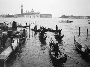 Gondolas and Gondoliers on a Rainy Day in Venice Italy, June 1965