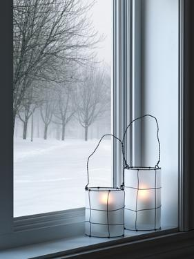 Cozy Lanterns and Winter Landscape Seen Through the Window by GoodMood Photo