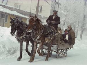 A Sleigh Serves as a Taxi on a Snow-Covered Village Street by Gordon Gahan