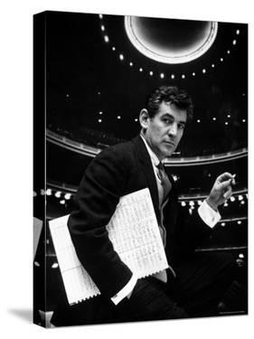 36 Year Old Composer Leonard Bernstein, Holding Musical Score with Lighted Auditorium Behind Him by Gordon Parks