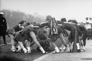 Hempstead High School Cheerleaders Chanting a Cheer as They Encircle the School's Tiger Mascot by Gordon Parks